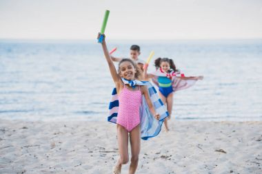 multicultural kids with water toys