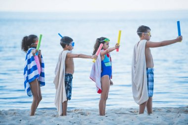 multicultural kids in swimming masks with toys