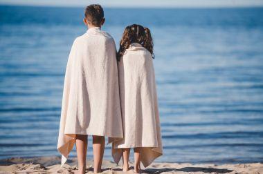 boy and girl on seashore