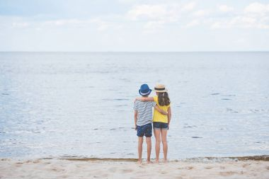 little boy and girl on beach