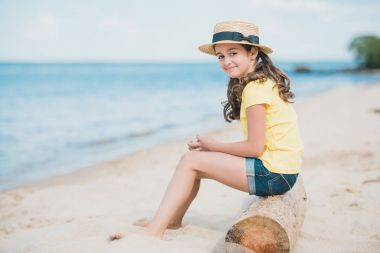 little girl sitting on beach