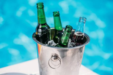 Bucket of cold beer near pool