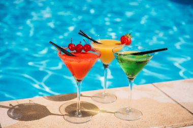 Colorful cocktails near pool