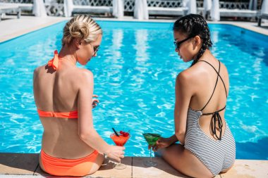 multiethnic women near swimming pool