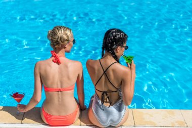 Multiethnic women near swimming pool