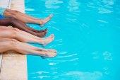 people lying near swimming pool