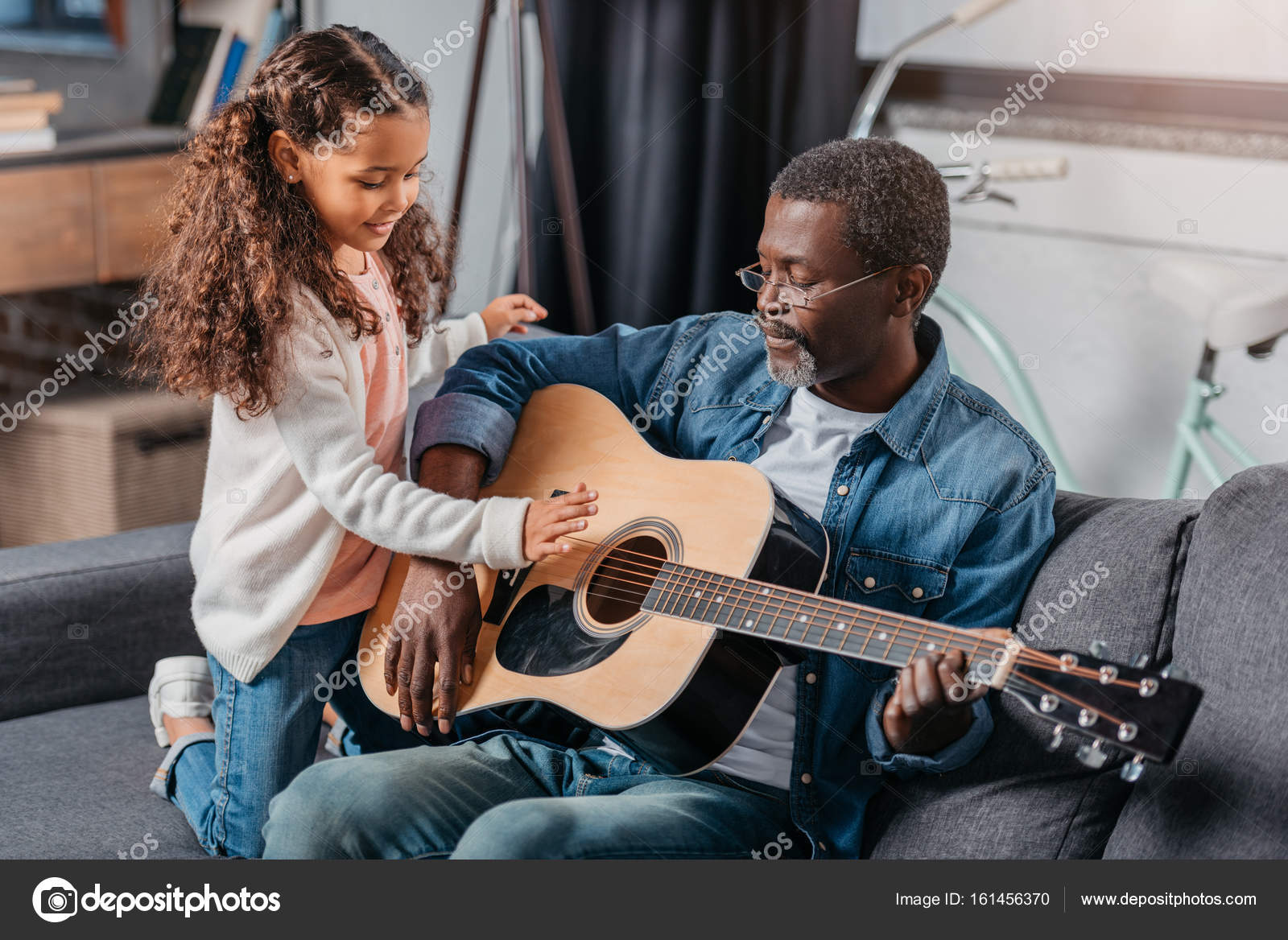 African American Man Playing Guitar With His Cute Daughter Photo By Alebloshka