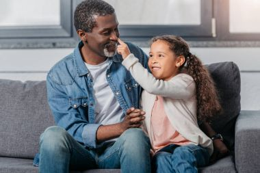 African american girl with father at home