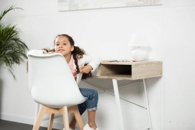 African american girl sitting on chair