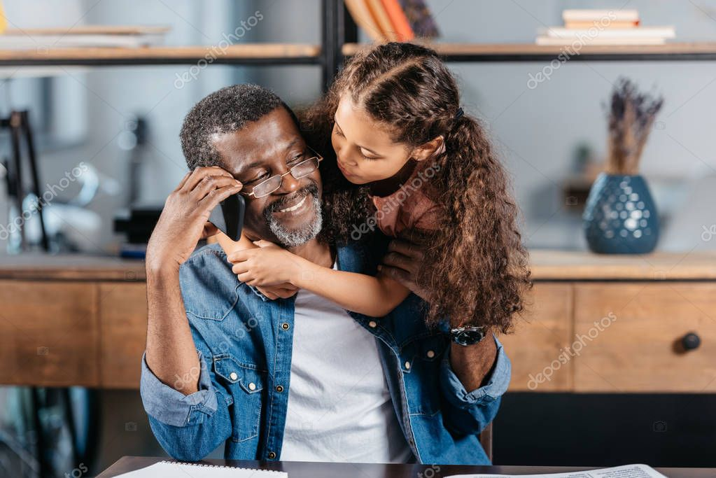 african american girl hugging father
