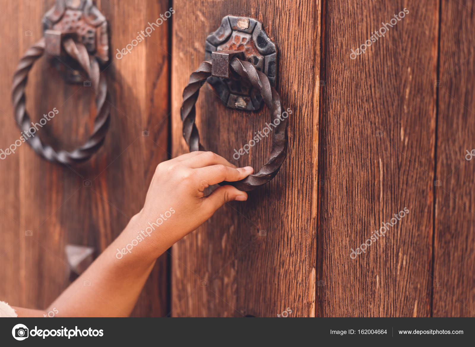 Cropped view of child knocking in door with metal handle \u2014 Photo by alebloshka & hand knocking in door \u2014 Stock Photo © alebloshka #162004664