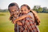 granddaughter hugging her grandfather