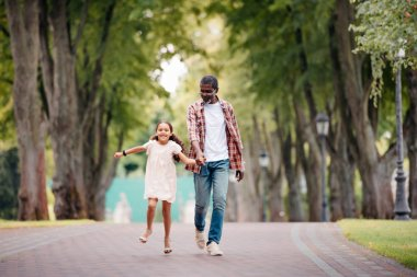 girl holding hands with grandfather