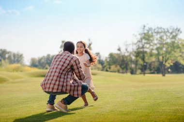 granddaughter running to grandfather