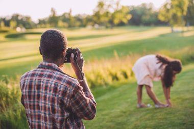 man taking photo of his granddaughter