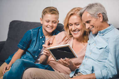 family looking at photo frame