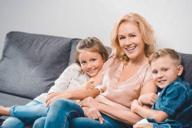grandchildren embracing grandmother