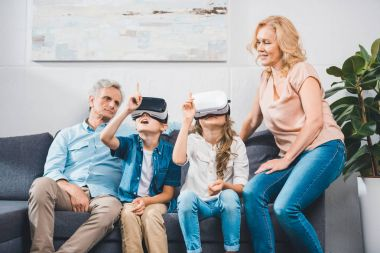 grandchildren using virtual reality headsets