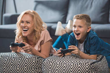 Grandmother and grandson playing video game