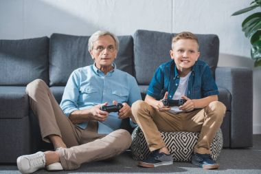 grandfather and grandson playing video game