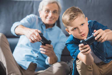 grandfather and grandson with joysticks