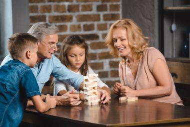 family playing blocks wood game