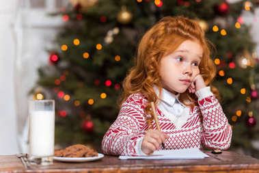 pensive child sitting at table