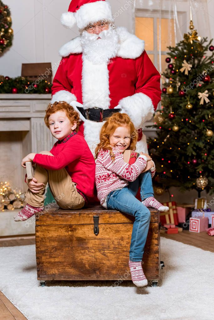 santa claus and little siblings