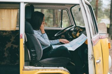 girl with map in minivan