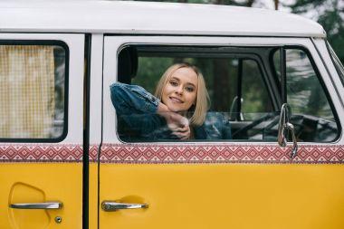girl sitting in retro minivan