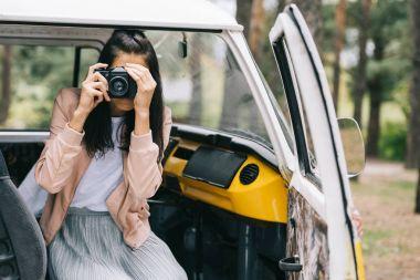 Girl taking photo on camera