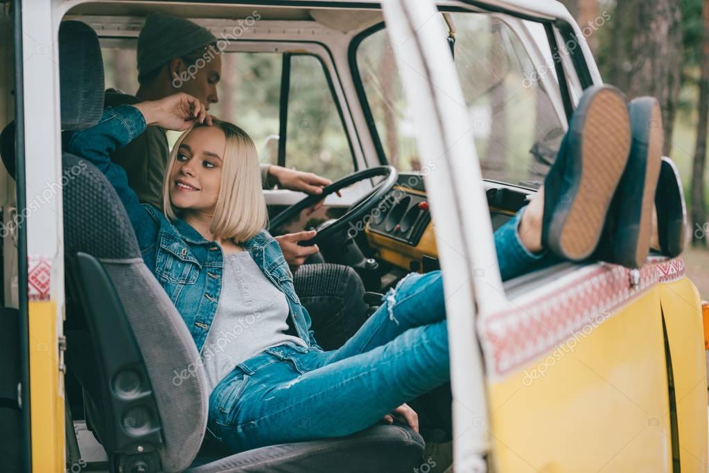couple of travelers in minivan