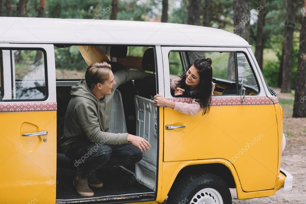 couple in retro minivan