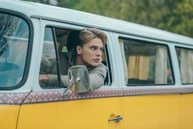 traveler driving retro minivan