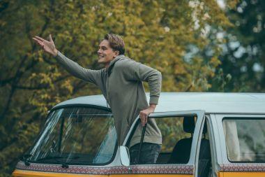 handsome man in retro minivan