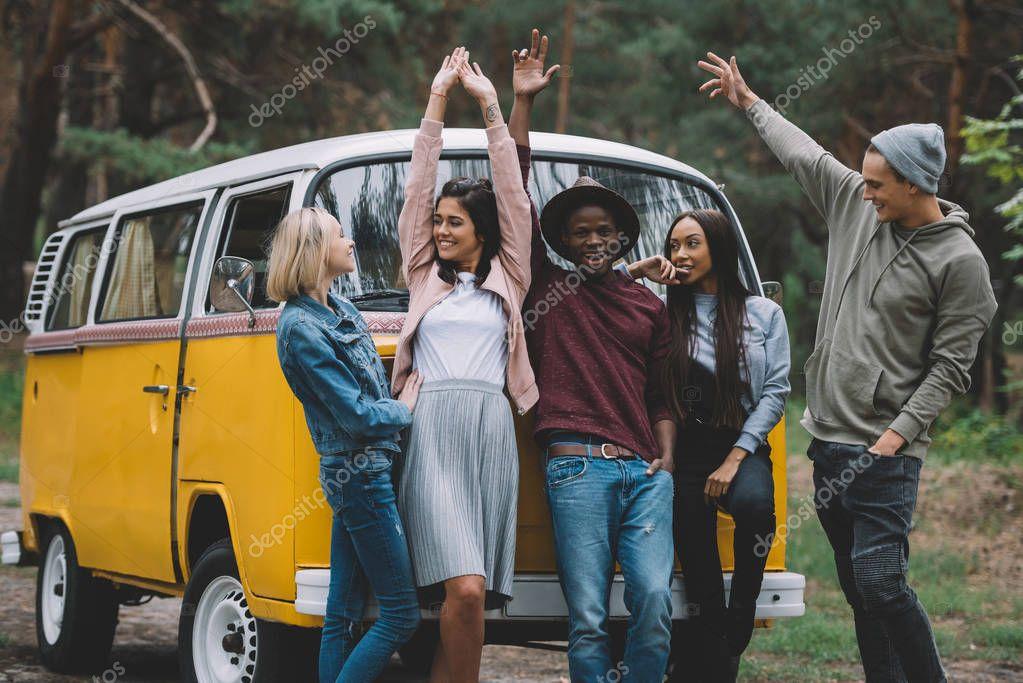 friends traveling by retro minivan