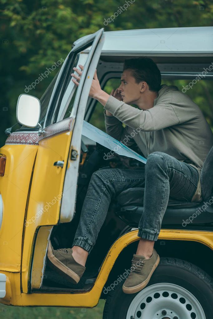 man in retro minivan