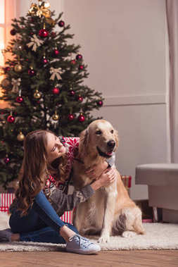 young woman and dog at christmastime