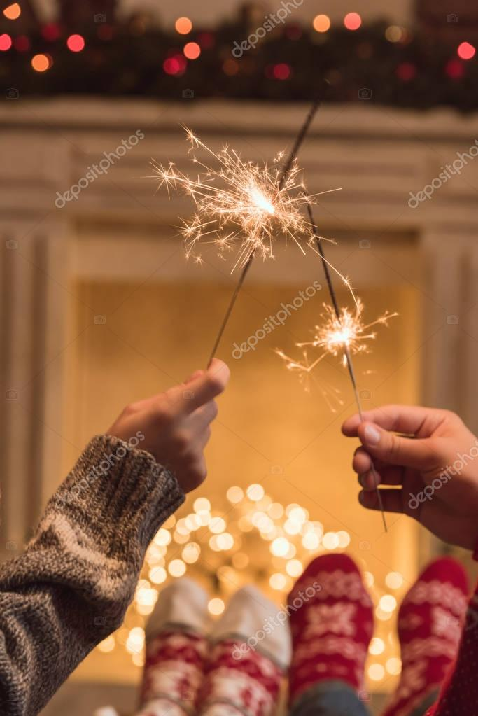 couple holding sparklers