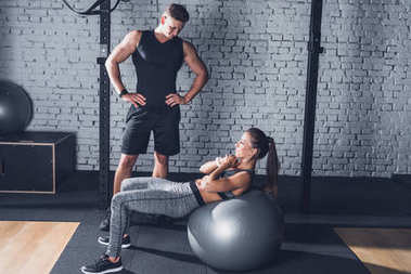 Woman exercising on fitness ball