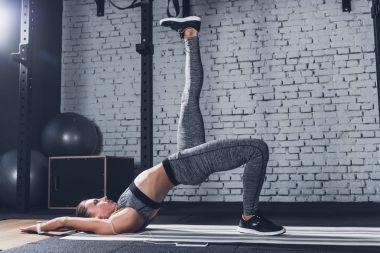 woman training on mat