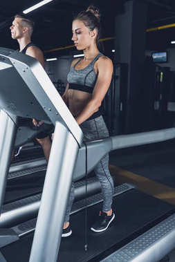 athletic woman exercising on treadmill
