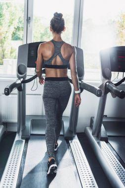 woman exercising on treadmill