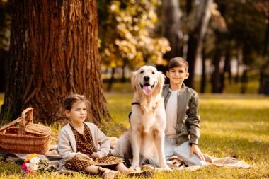 children and dog in park