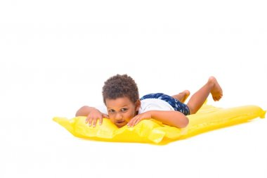 african american boy on swimming mattress