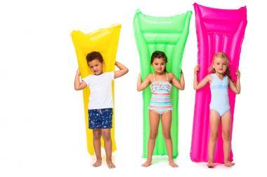multiethnic kids with swimming mattresses