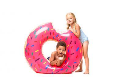 multiethnic kids with swim tube