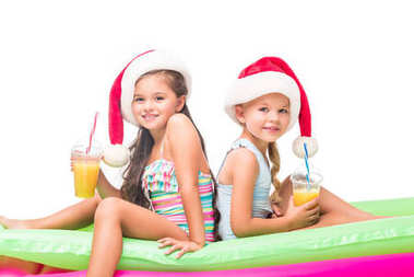 kids in santa hats with orange juice