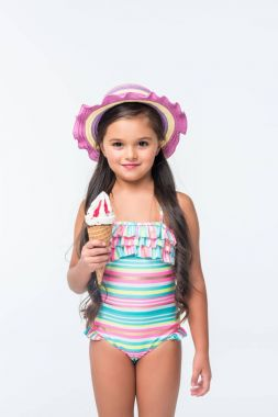 child in swimsuit with ice cream