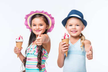 happy kids in swimwear with ice cream